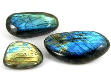 Polished and natural crystals, spheres, freeforms and pebbles of  Labradorite