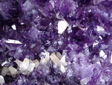 Polished and natural crystals, spheres, freeforms and pebbles of  Amethyst