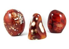 Polished and natural crystals, spheres, freeforms and pebbles of  Carnelian